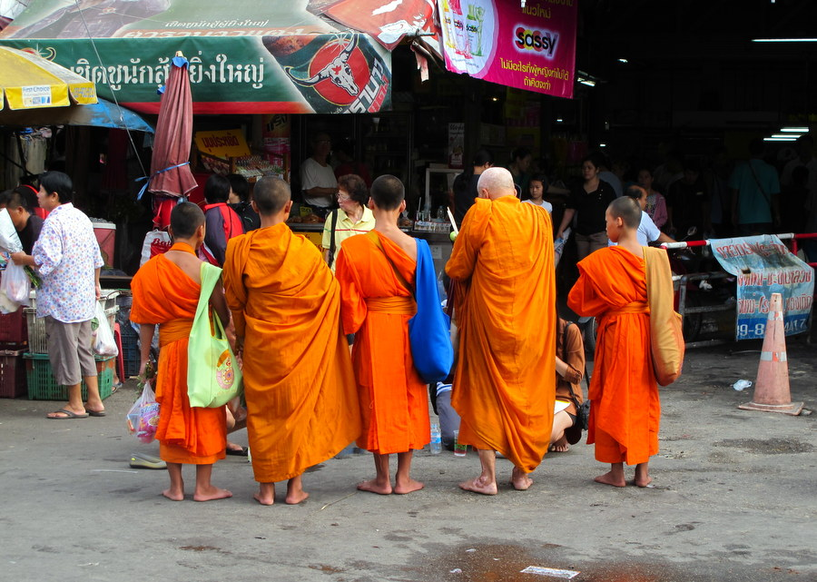 Monks in the morning At Chiang Mai Gate waiting for offerings
