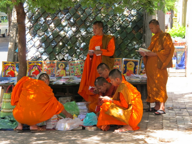 Young Monks buying books if front of a Buddhist University