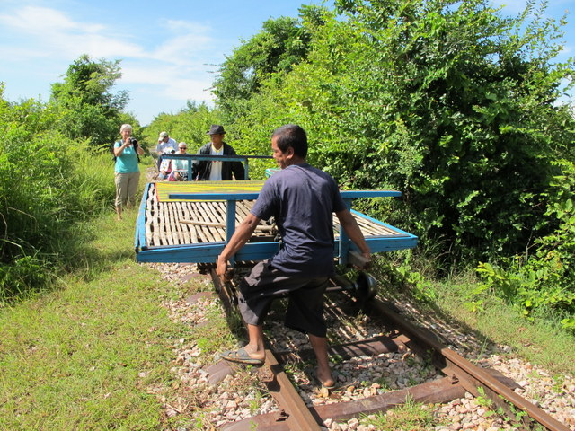 Dismantling a Bamboo Train car so another could pass