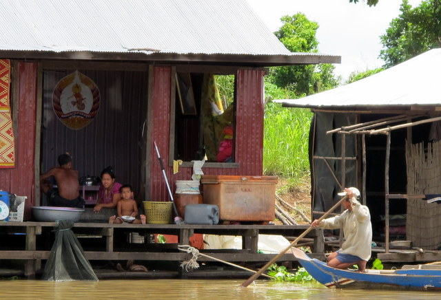 Families in houses along the river