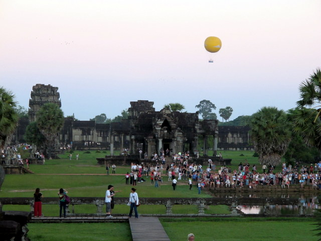 Crowds gather for the dawn breaking over Angkor Wat