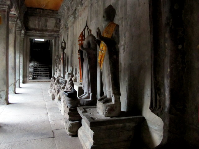 Long gallery filled with statues and fragments of sculpture at Angkor Wat