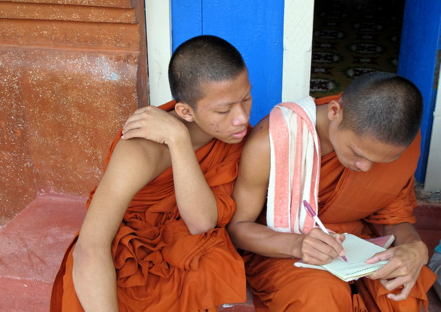 At Wat Prasat Bakong a monks write his email address in English