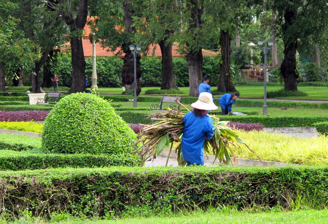 In Siem Reap keeping the Royal Gardens manicured.