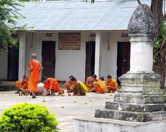 Monks at work at Vat Pak Khan...Luang Prabang, Laos