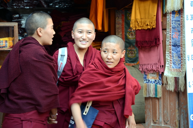 At Boudhanath young monks shop and enjoy a laugh