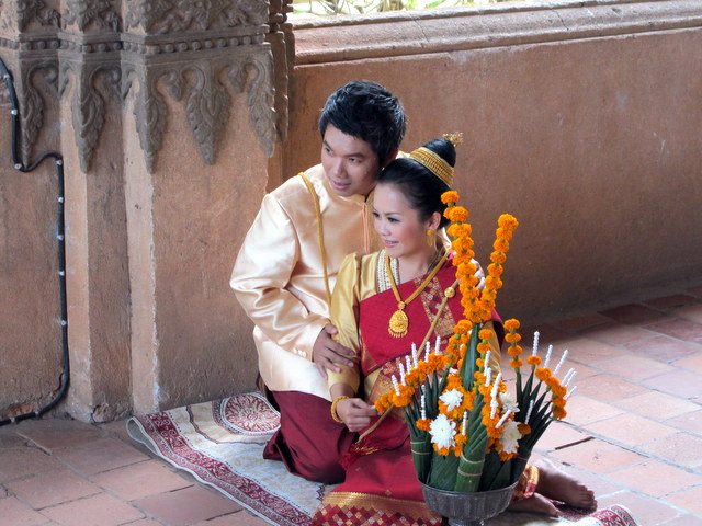 Newlyweds pose for a formal photo at Haw Pha Kaew Temple...Vientiane Laos