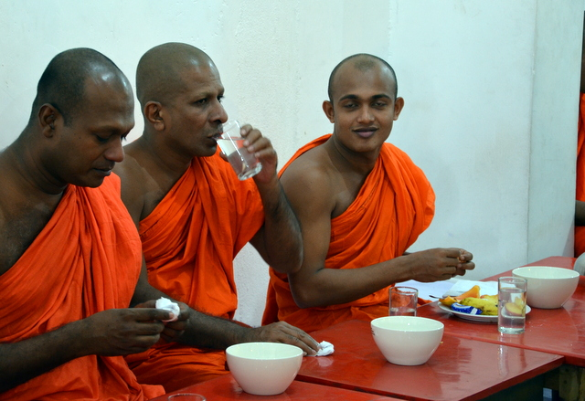 Monks at lunch in the Gangaramaya Temple