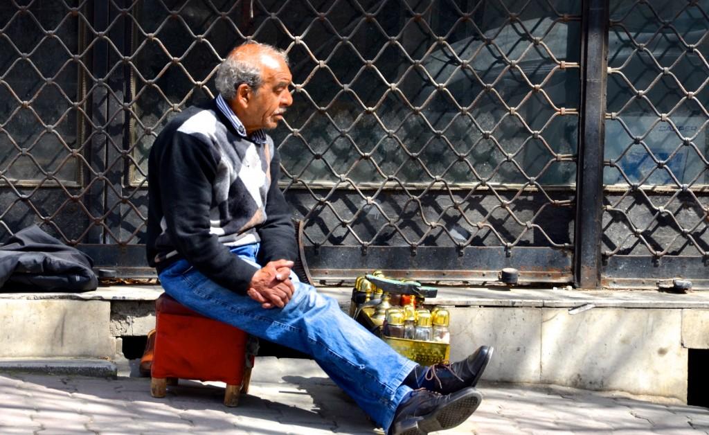 Shoeshine man waiting for a customer