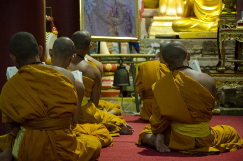 Buddhist Monks chanting in a temple in Chiang Mai.